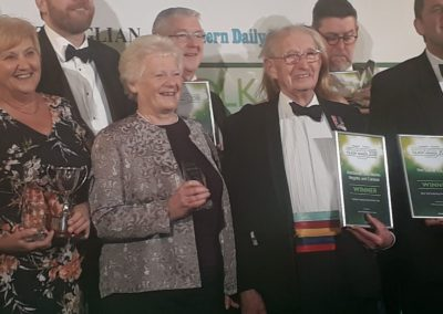 Judy and Keith accept the award